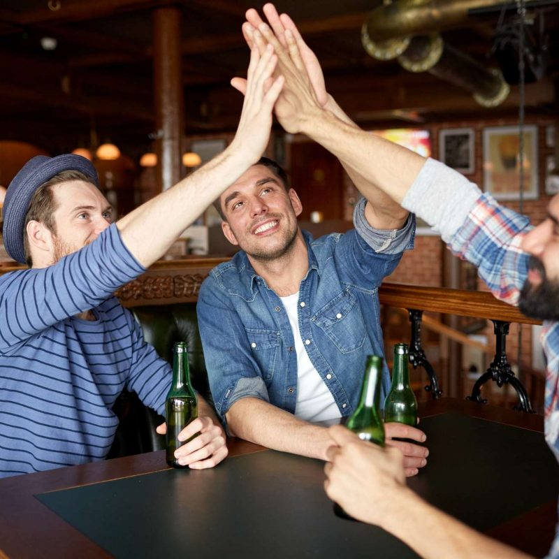 guys high five at bachelor party