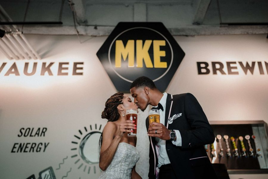 Bride and Groom kissing at Milwaukee Brewing Company