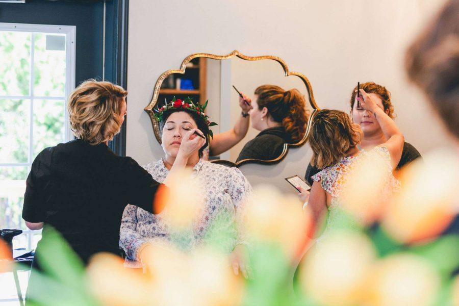 Bride having make-up applied at Aqua Beauty Lounge & Med Spa