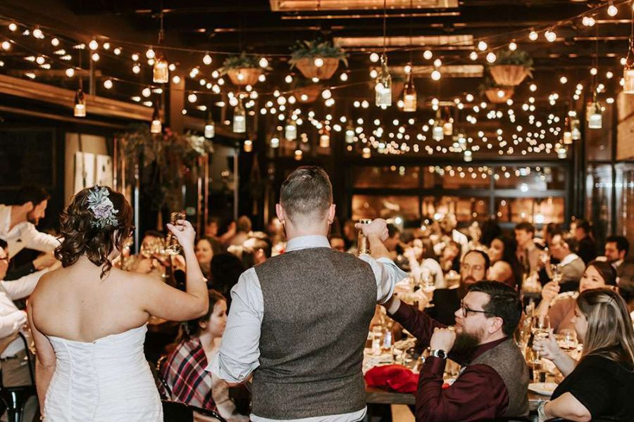 Bride and groom toast at their Pizza Man wedding