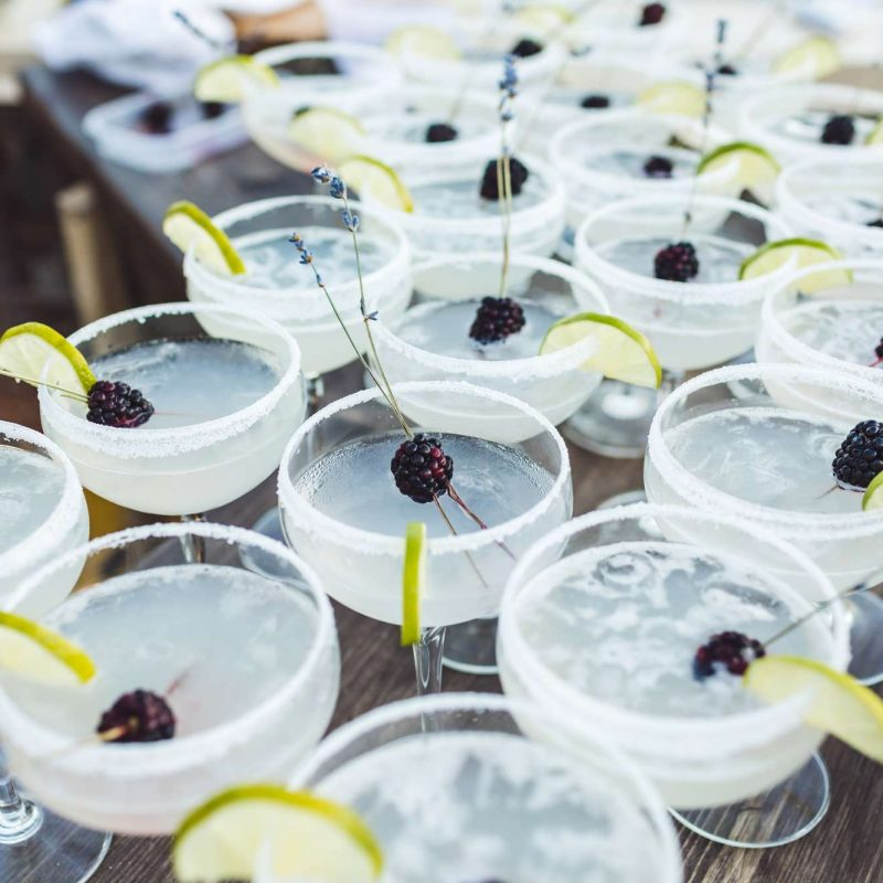wedding margarita with lime and berry garnish