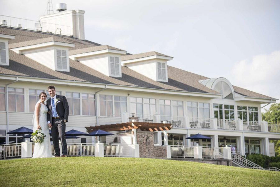 Bride and groom pose outside of Geneva National Resort & Club