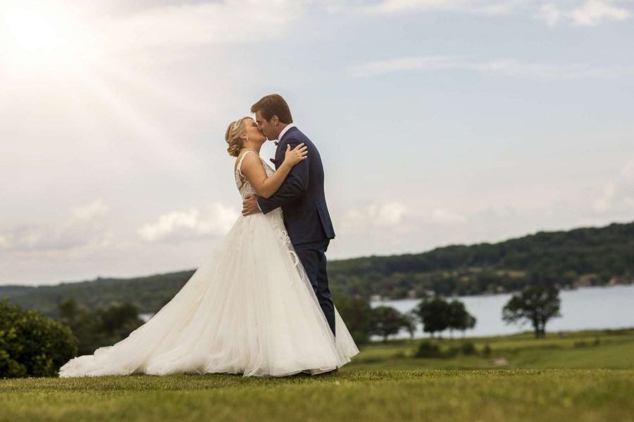 Bride and groom embrace   Geneva National Resort & Club
