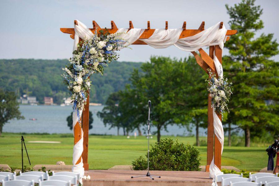 Wedding ceremony pavilion with arch at Geneva National Resort & Club