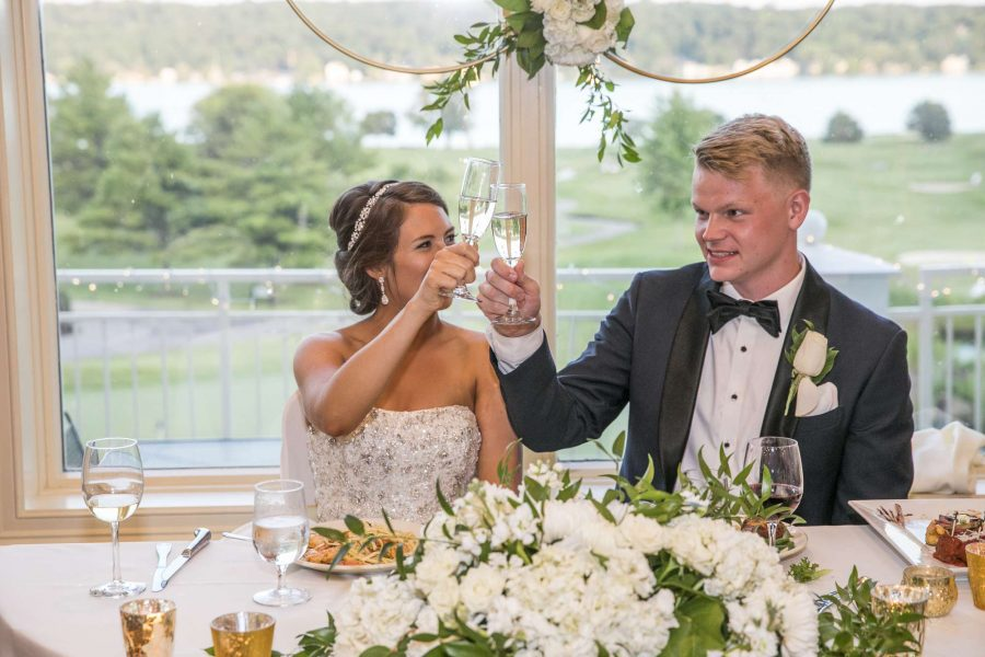 Bride and Groom toast with champagne at the Geneva National Resort & Club