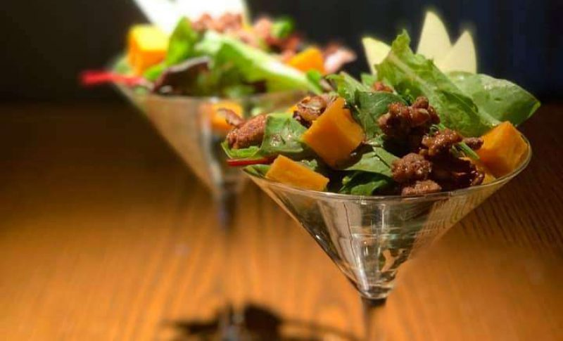 Mini salad served in a martini glass by Louise's Catering