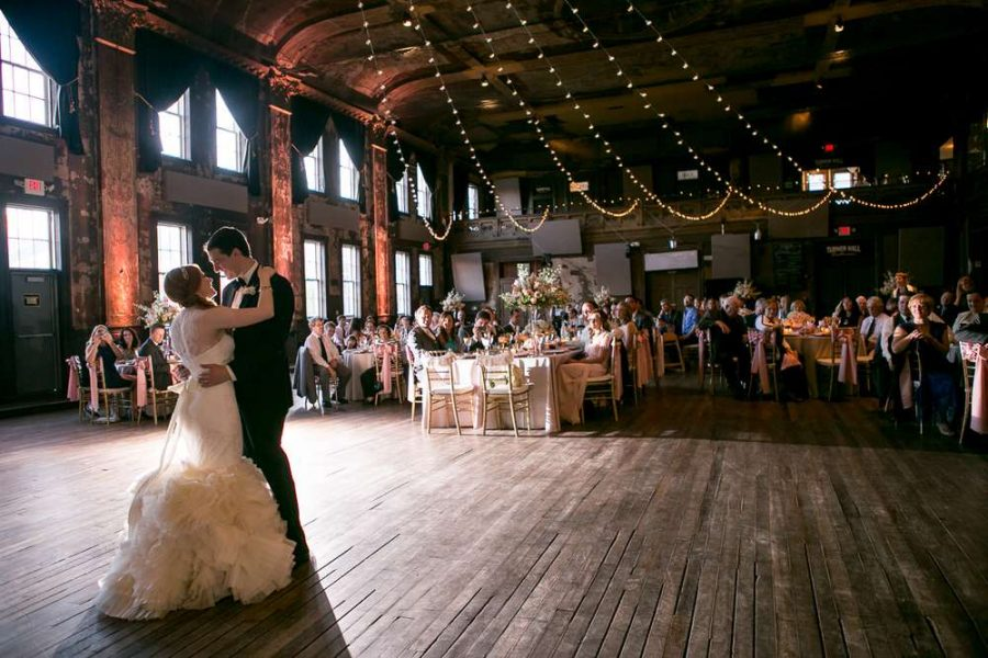 First dance for bride and groom on beautiful wood dance floor at historic Turner Hall with lighting strung on ceiling