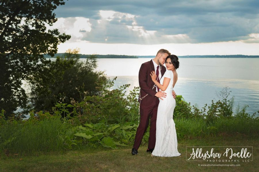 Groom kisses bride lakeside- Allysha Noelle Photography