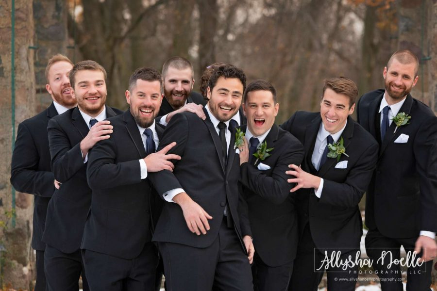 Groomsmen laugh while they pose- Allysha Noelle Photography