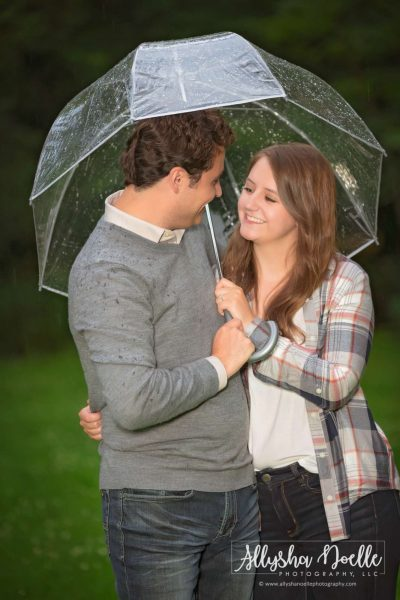 Engagement photo-couple under umbrella