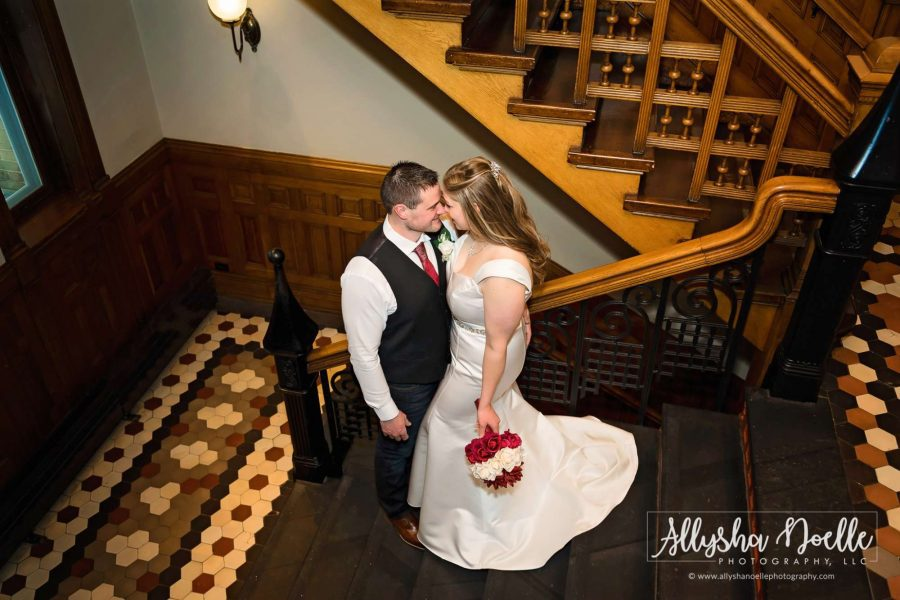 groom kisses bride on steps-Allysha Noelle Photography