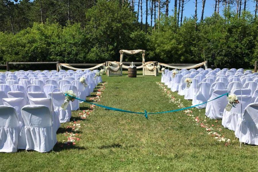 Wedding ceremony site with drapped chairs at the Kettle Moraine Ranch in Eagle, WI