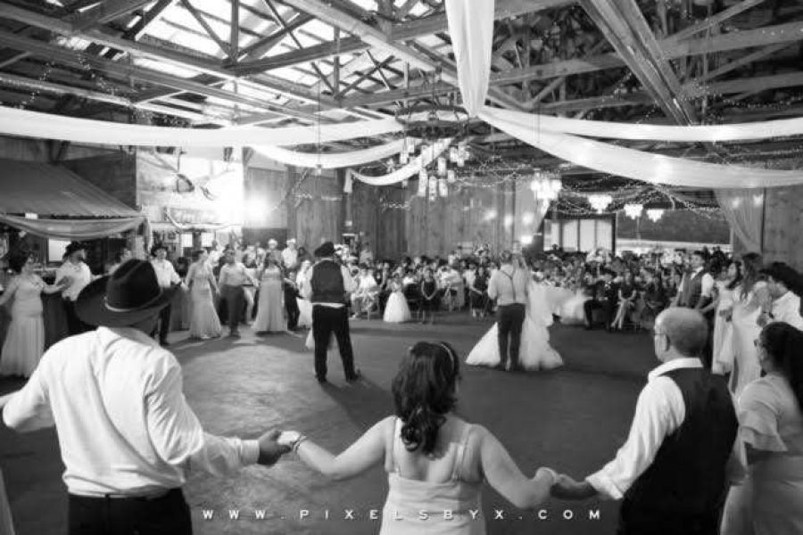 Barn wedding with guests dancing at Kettle Moraine Ranch