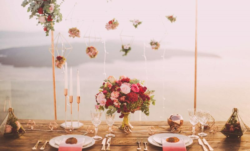 wedding backdrop and table setting with floral accents and candles