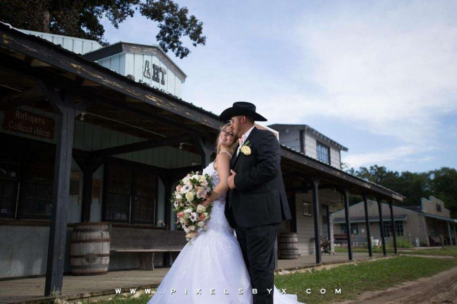 Bride and groom pose at the Kettle Moraine Ranch