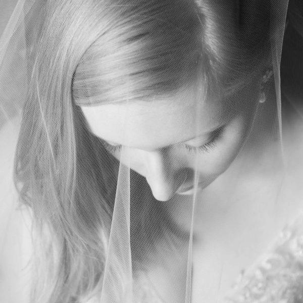 Beautiful veiled bride looking down