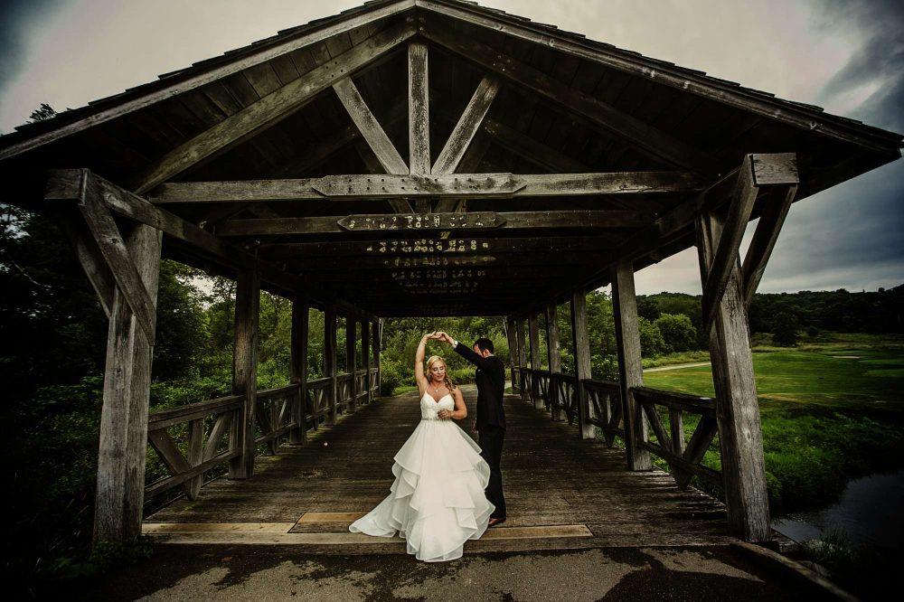 bride and groom dancing in rustic barn lake geneva