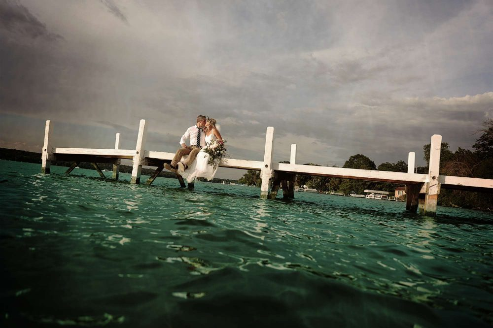 Bride and Groom on a pier in Lake Geneva