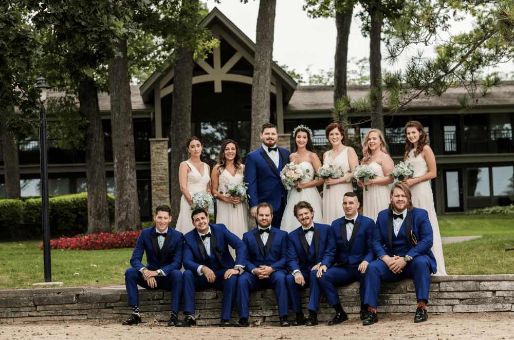 Groom and Bride Stand with wedding party in navy and pink