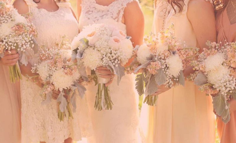 Bridal party holding their bouquets