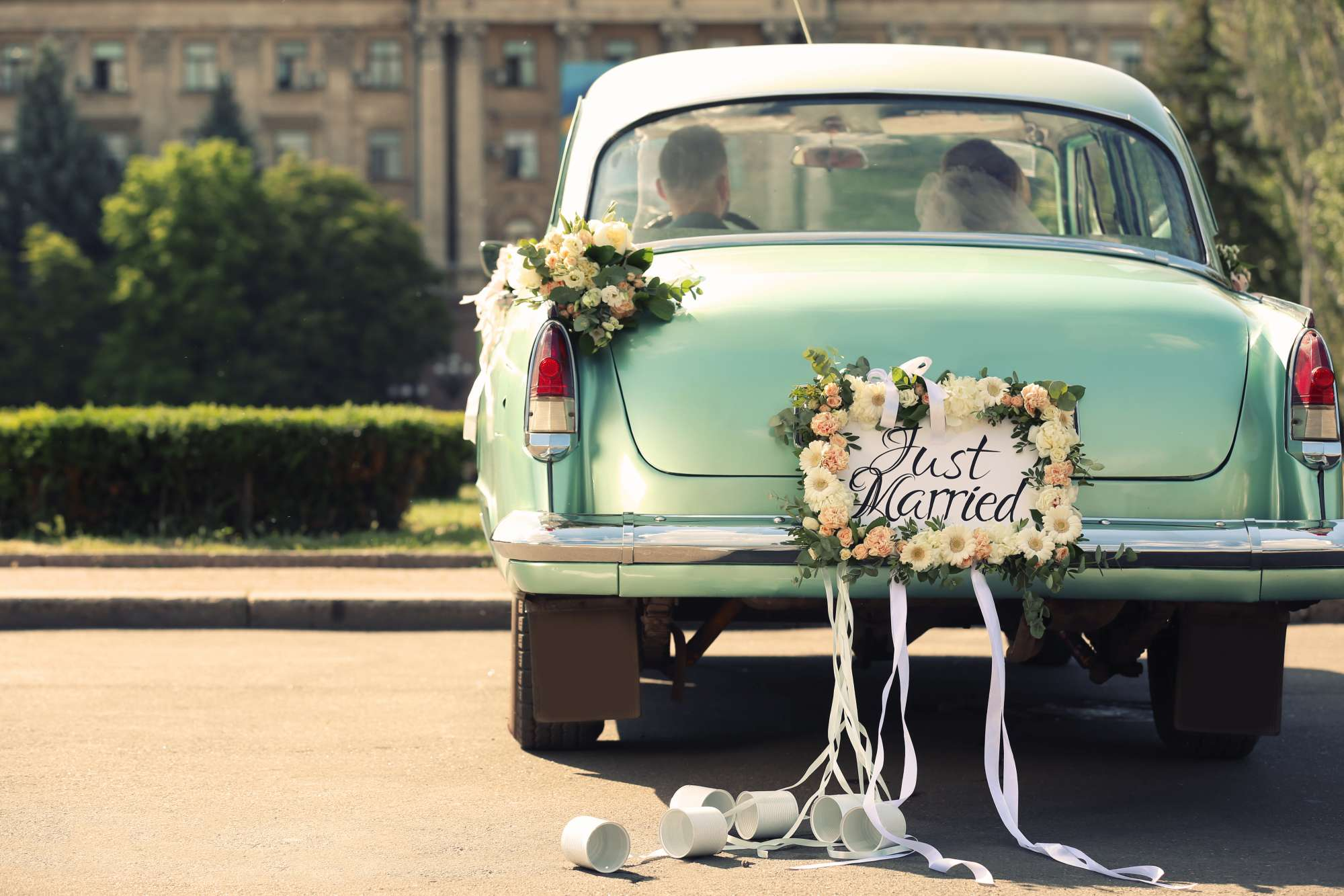 just married sign on vintage cool mint green car