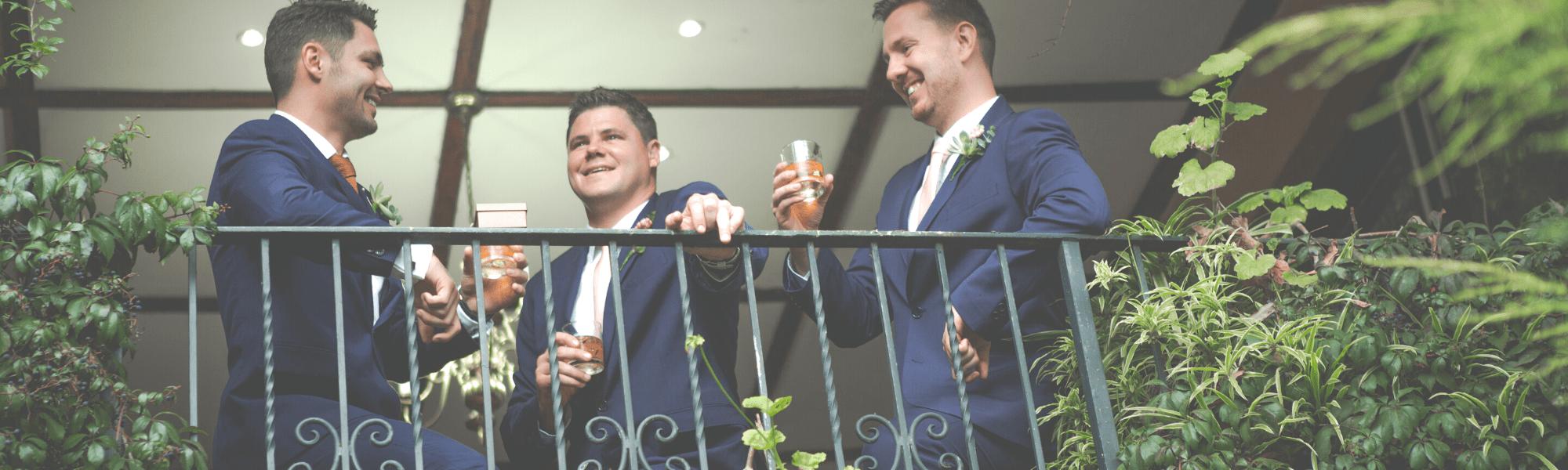 Groom with groomsmen on balcony