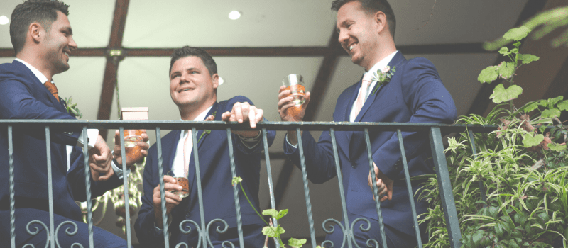 Groom with groomsmen on balcony