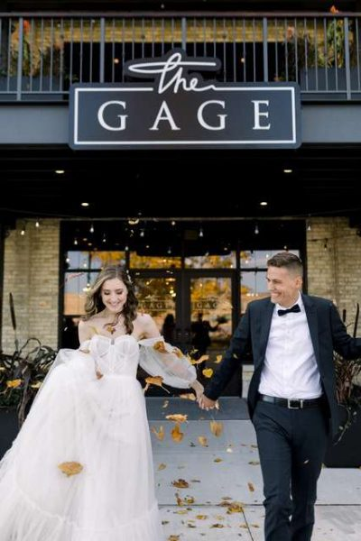 Bride and groom outside of the Gage in Milwaukee