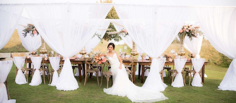 Stunning bride sits at her head table