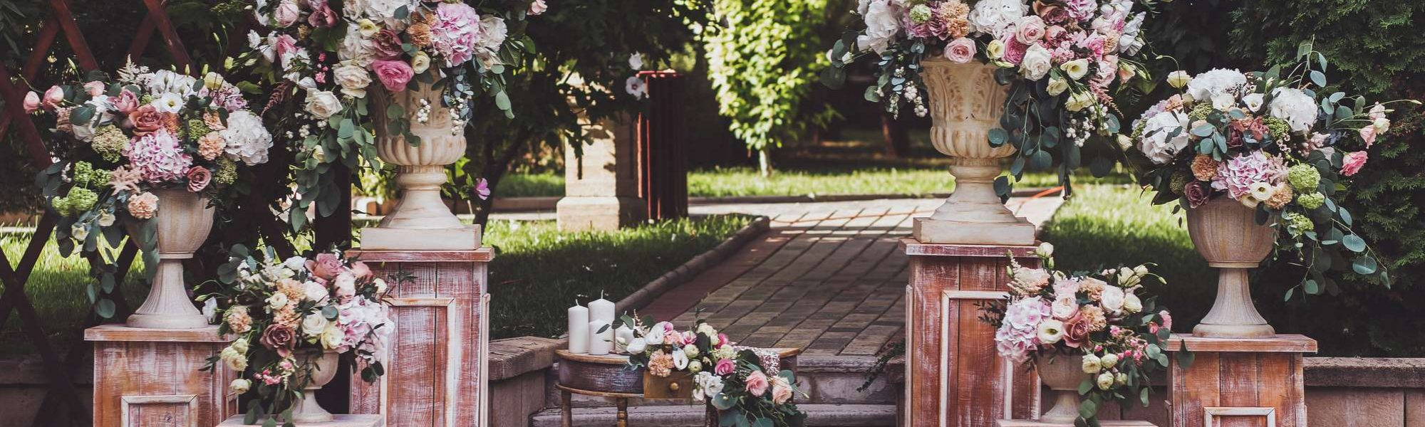 beautiful floral outdoor wedding display with pinks and greenery