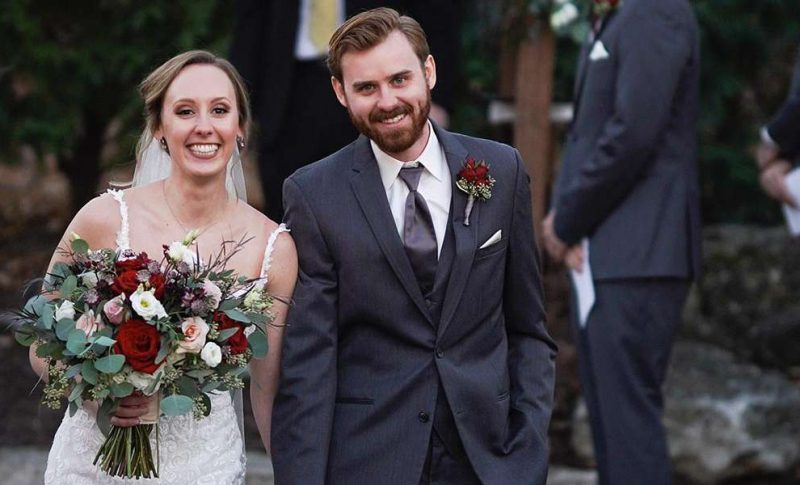 Rachel and Derrick smile at ceremony recessional