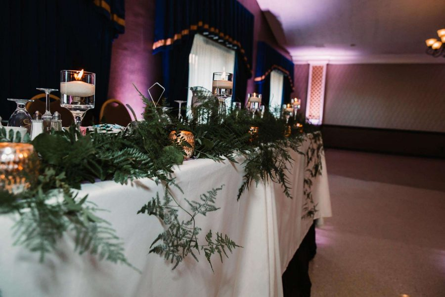 Greenery by 88Events on front of wedding table