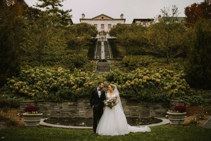 Bride and groom pose at the Villa Terrace in Milwaukee, WI - Image by DeGroot Film Co.
