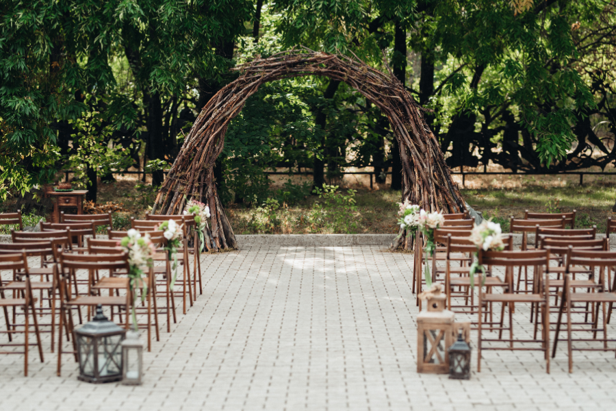 Woodland themed wedding arch created out of vines and branches
