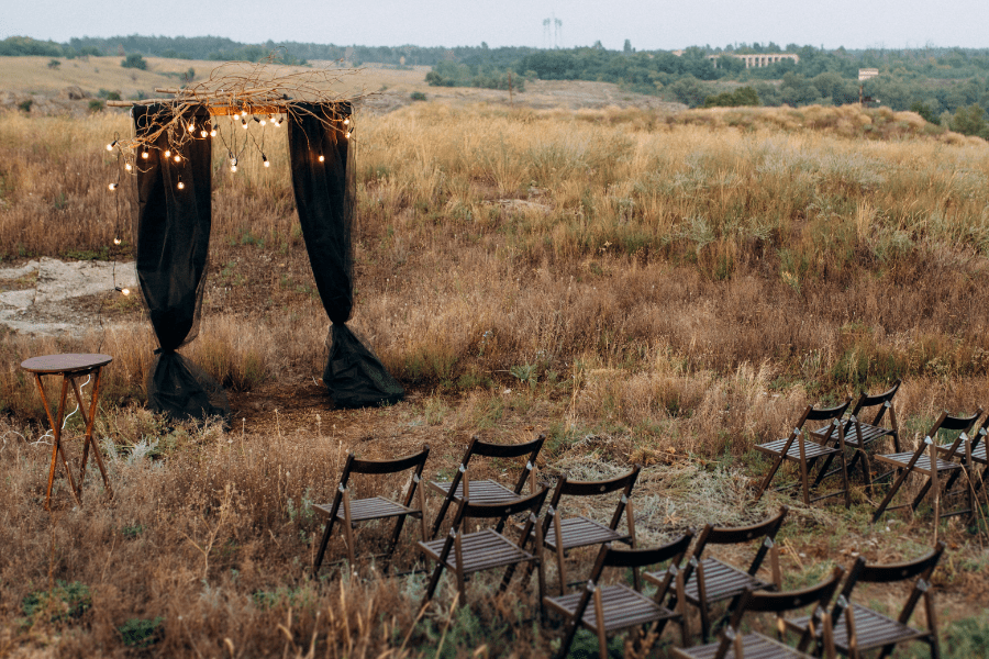 Black linen drapes with mini lights creates some backdrop drama fro your wedding day.
