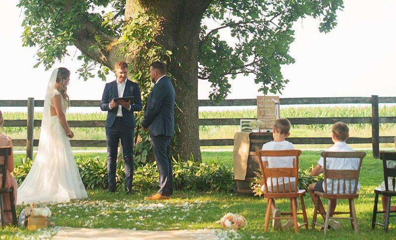 Ashley and Jason's wedding under the old oak tree at Sugarland