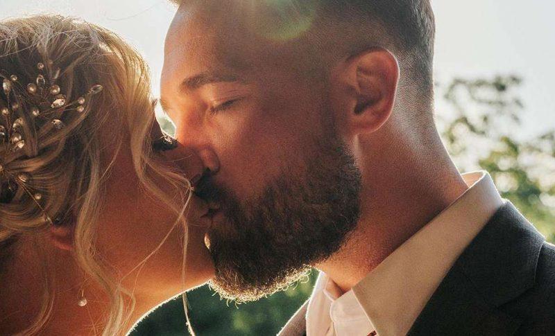 Ashley and Jon kiss as sun sets
