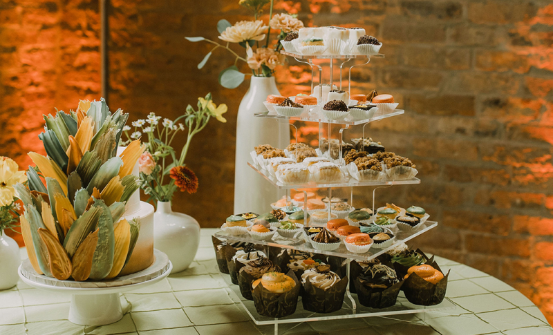 Wedding cake and dessert station display by Sweet Perfections Bake Shoppe