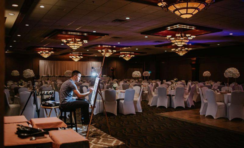 Live wedding painter Brad Geers working on painting