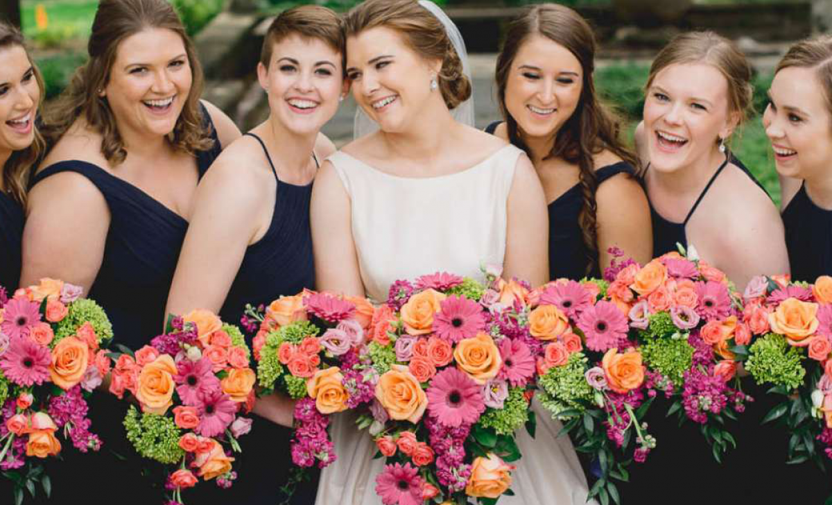 Bride and her bridesmaids with bouquets from Belle Fiori